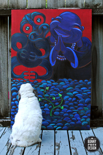 Tofu the bunny takes a moment to admire a painting